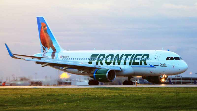 A Frontier Airlines plane on the runway.