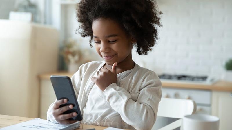 Little girl on wireless phone.