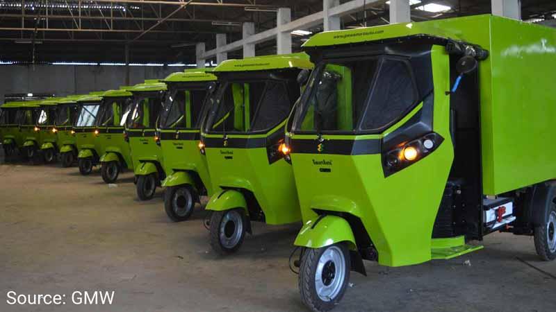 Fleet of GMW electric three-wheeler delivery trucks.