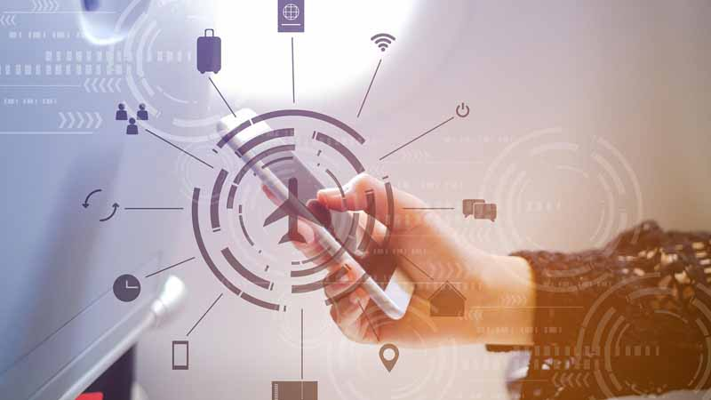 Digital travel concept over a businesswoman in an airplane using smartphone.