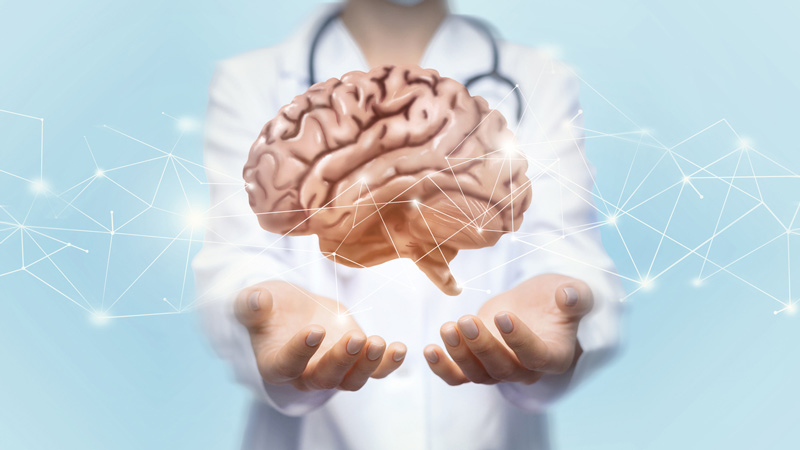 Abstract image of brain hovering over a doctors hands.
