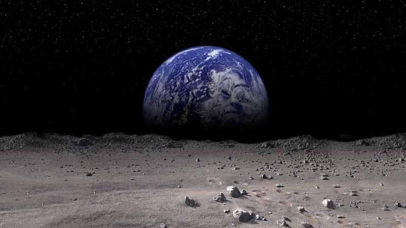Earth rising on the Moon's horizon.