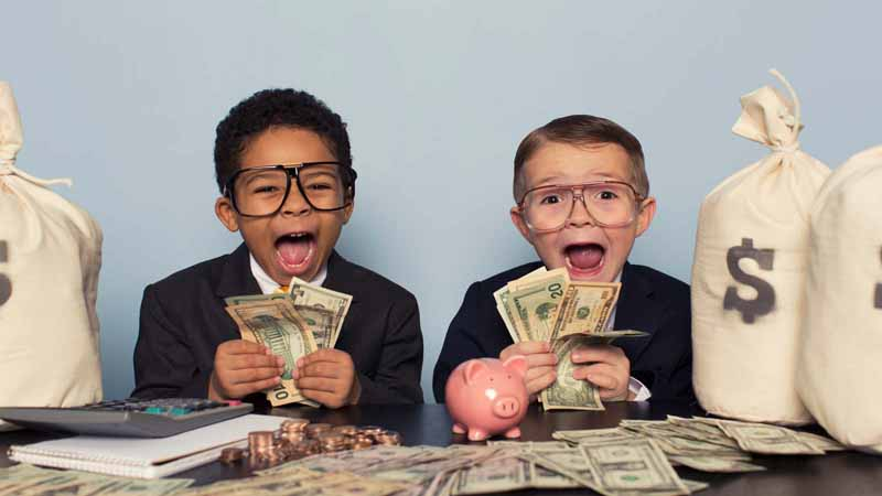 Children in business suits holding lots of money.