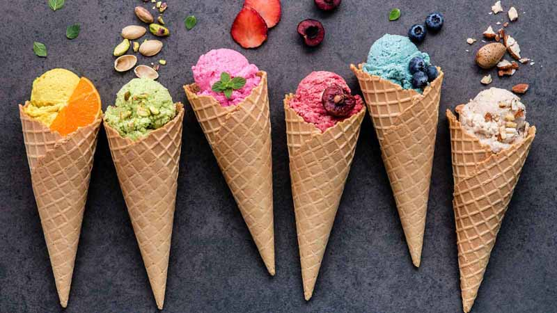 A row of different-flavored ice cream cones.