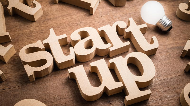 """""""Startup"""" spelled with wooden letters."""
