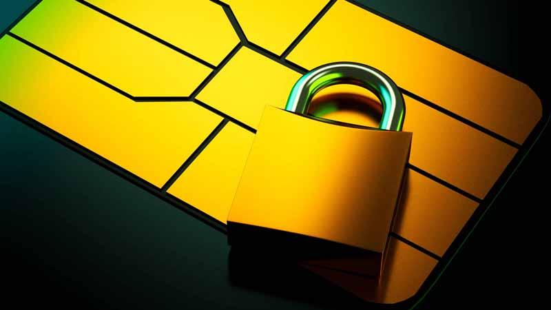 Closeup of a credit card chip and padlock.