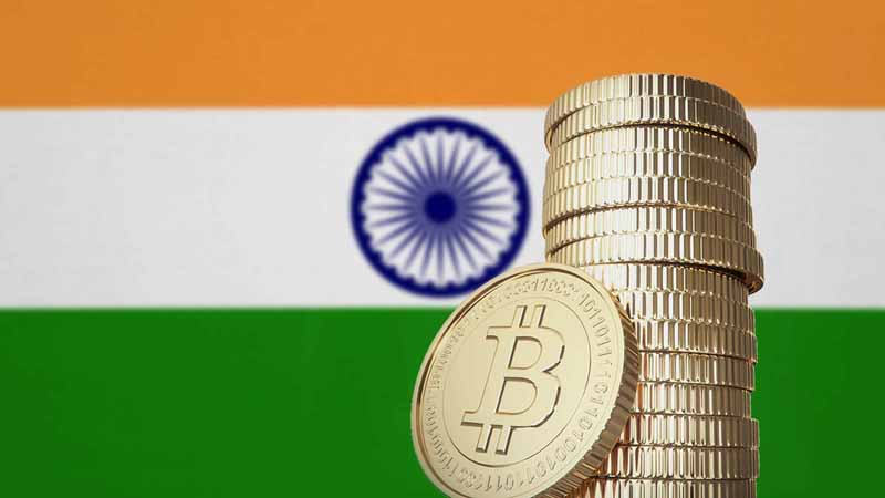 Bitcoin stacked in front of the India flag.