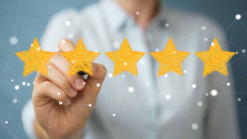 A person drawing a five-star rating.