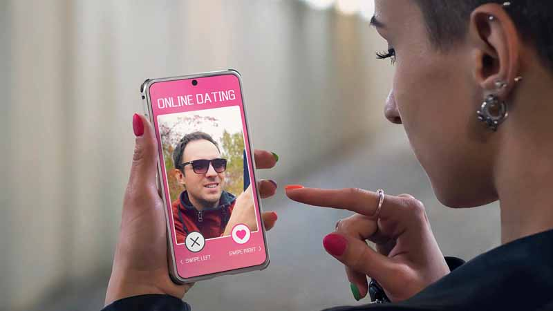 A young woman using a smartphone dating app.