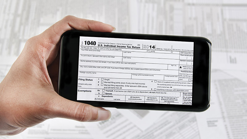 A 1040 tax form on a smartphone.