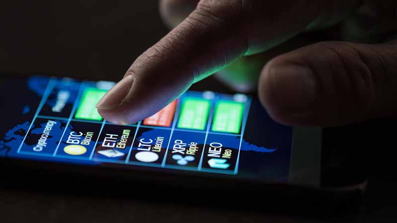 A person checking cryptocurrency exchange rates on a smartphone.