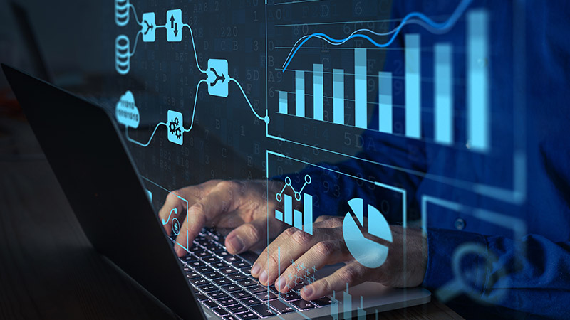 Businessperson working with data analytics on a computer.