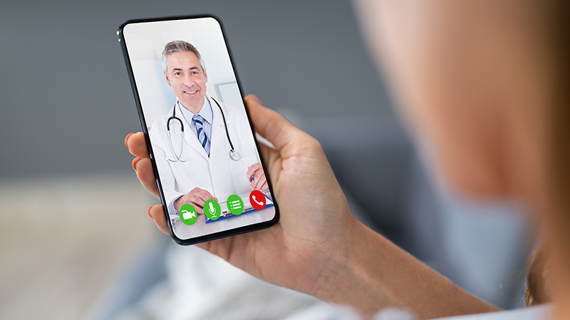 A patient video chatting with a doctor.