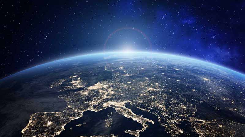 Earth viewed from space as the sun rises.