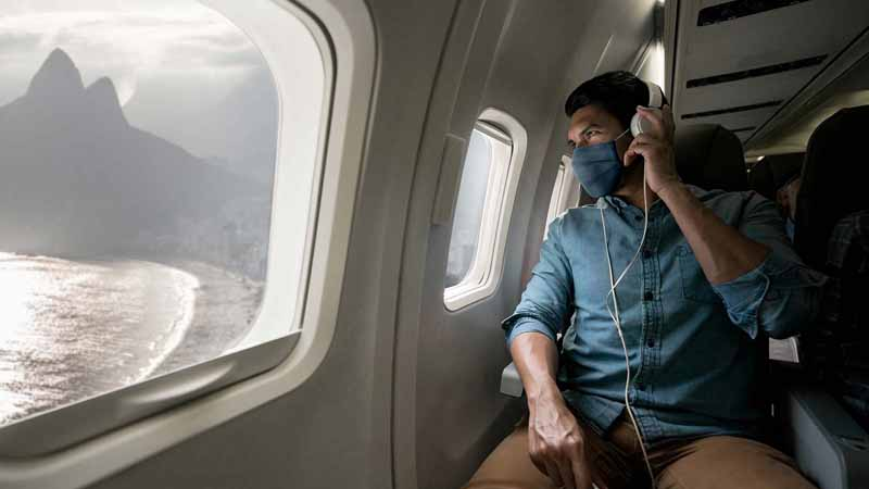 Man traveling in a plane.