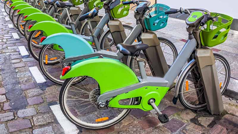 A row of rentable electric bikes.