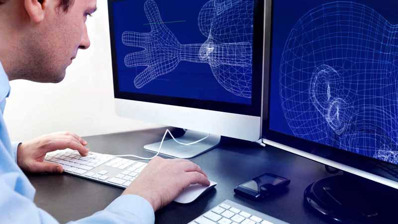 A designer working on 3D renderings.