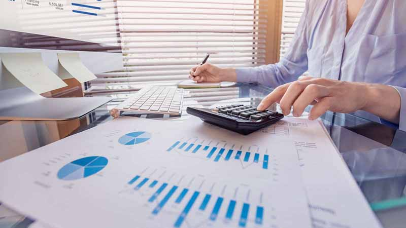Entrepreneur working on financial reports.