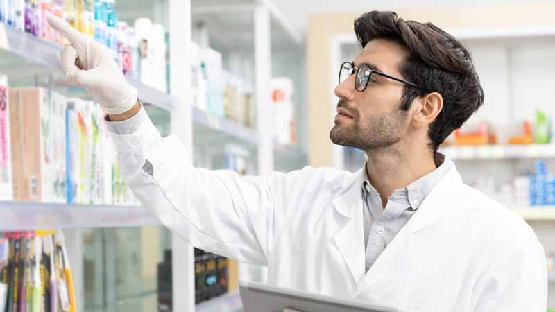 A pharmacist checking his inventory.