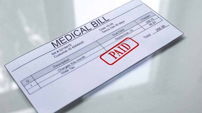 """Medical bill stamped with a """"paid"""" stamp."""