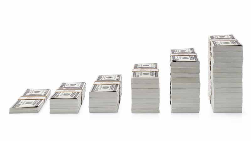 Dollar bills stacked up.