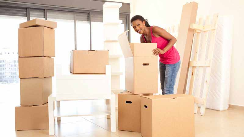 Woman packing moving boxes.