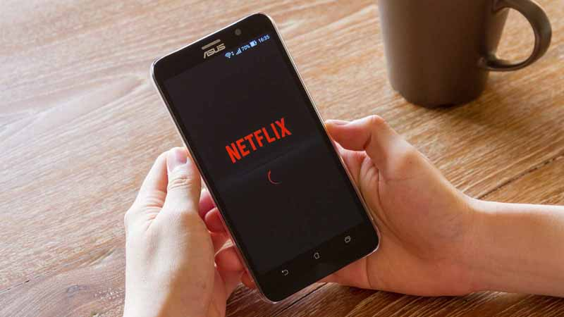 A phone with Netflix on its screen