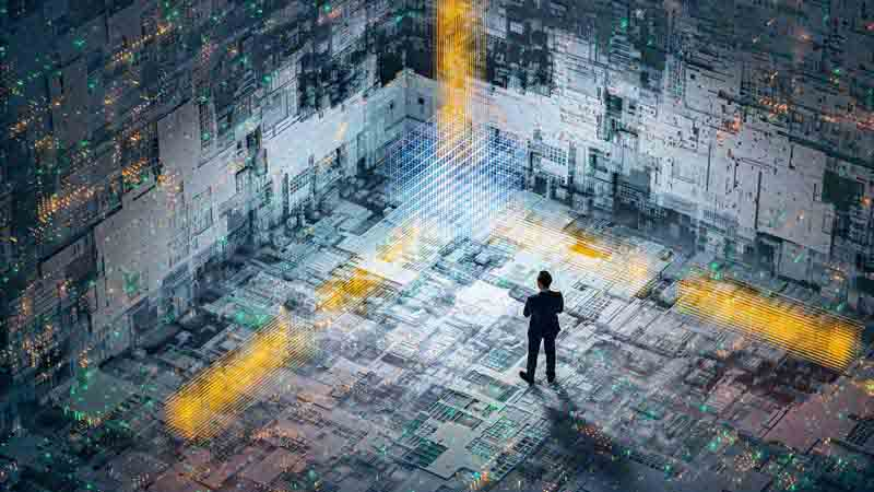 Businessman standing in an abstract technology setting.