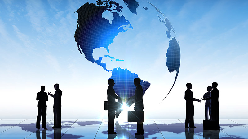 Silhouettes of a business team and globe.