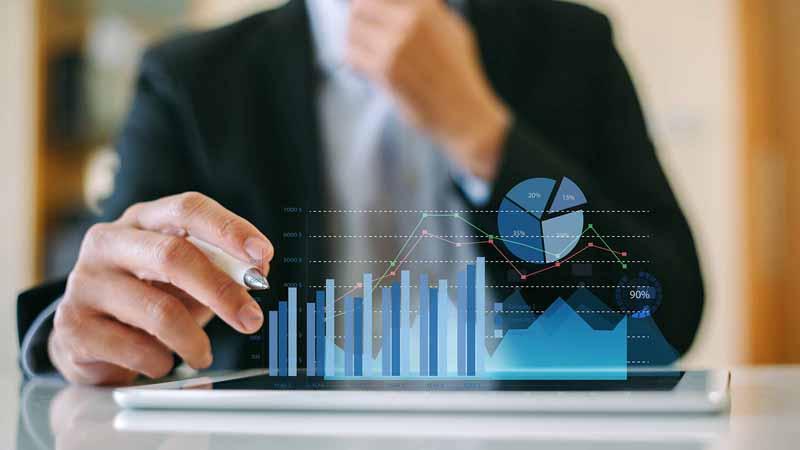 Businessman analyzing digital charts.