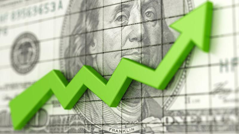 Upward trending finance graph on a hundred dollar bill background.
