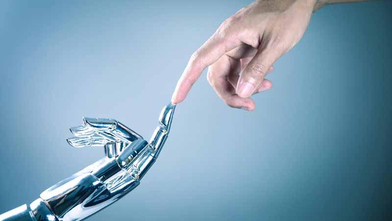 AI Machine, robot hand touching a human hand.