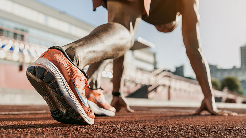 Closeup of an athlete getting ready to run.