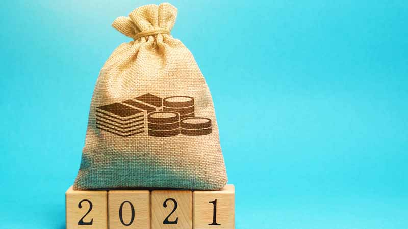 Money bag on top of wooden blocks that say '2021.'