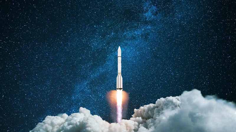 A rocket flying into space.