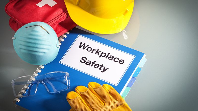 Workplace safety handbook and safety equipment.