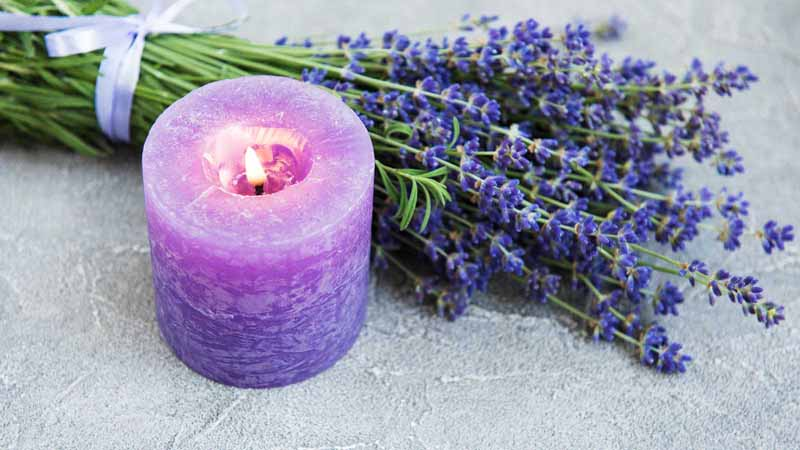Lavender flowers and a lavender candle.