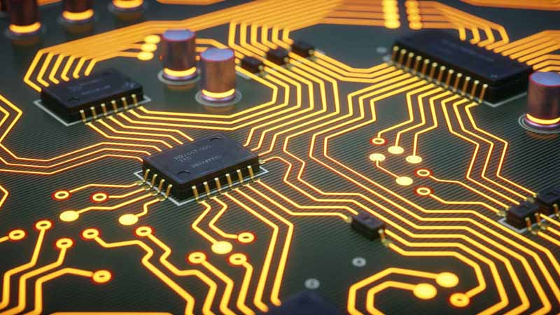 Close-up of a yellow circuit board.