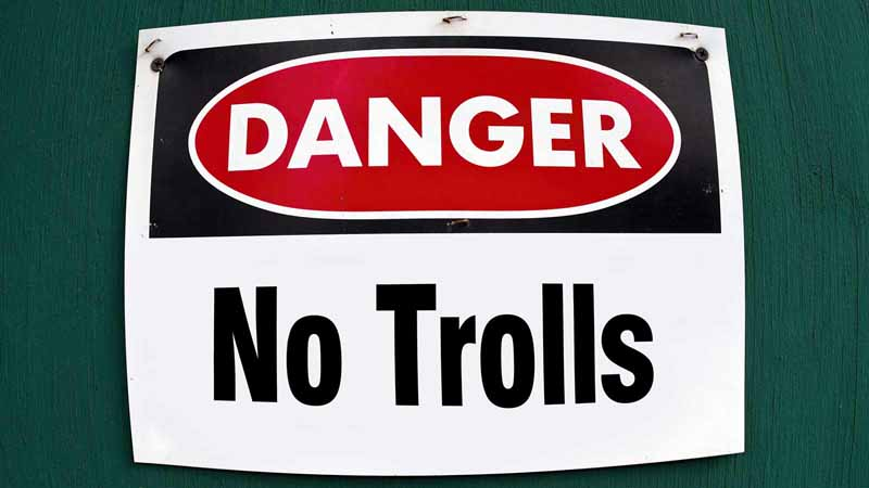 Sign reading 'Danger, No Trolls.'