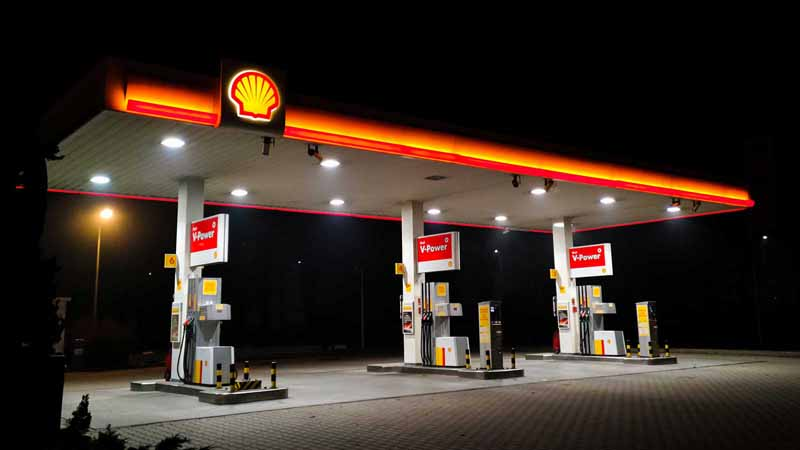 A Shell gas station at night.