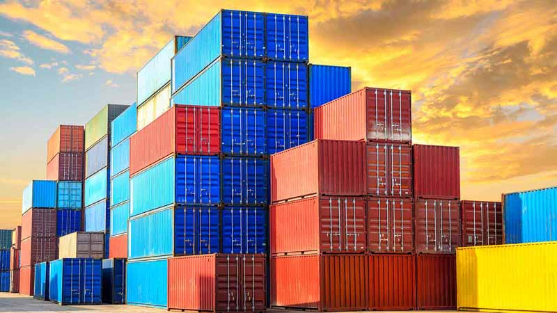 Multiple shipping containers stacked on top of each other.