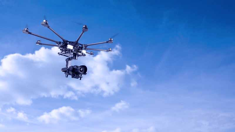 Drone on a background of beautiful blue sky.