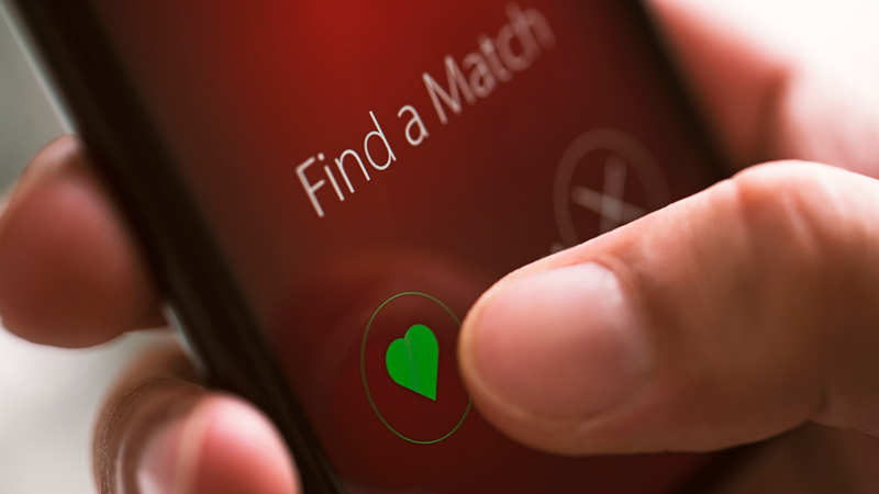 Online dating app on mobile phone screen.