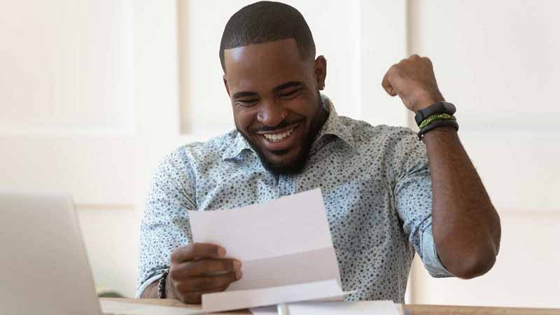 Happy man receiving a financial approval.