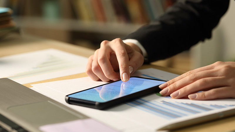Person signing a contract on a smartphone.