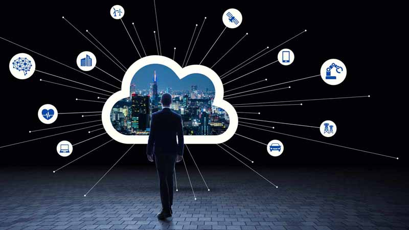 Businessman standing in front of cloud computing concept.