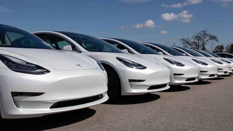 A row of Tesla vehicles.