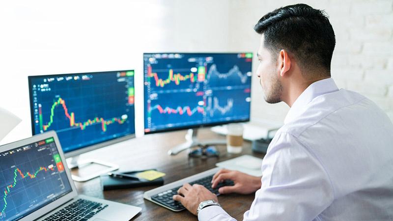 A stock trader viewing financial charts.