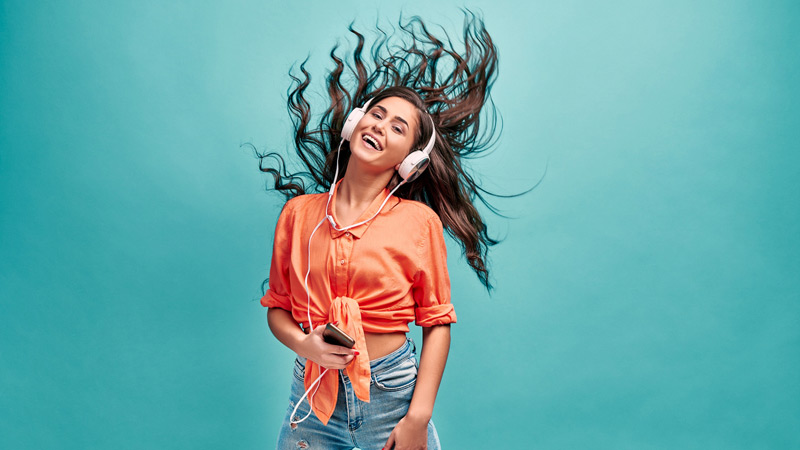 A woman dancing with headphones.