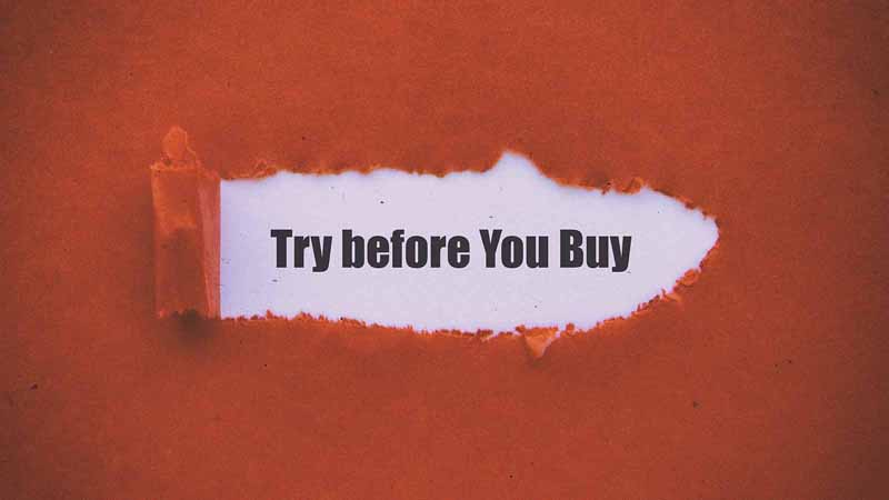 Torn paper that reveals text reading 'try before you buy.'